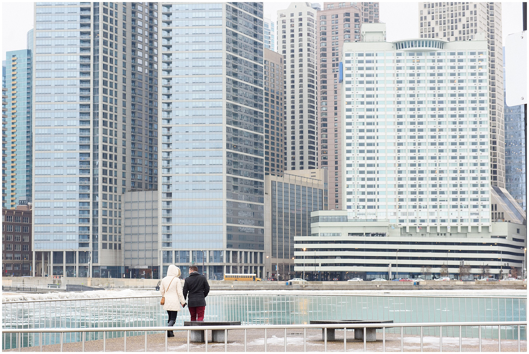 The couple arrives and walks hand in hand prior to a Chicago skyline proposal.