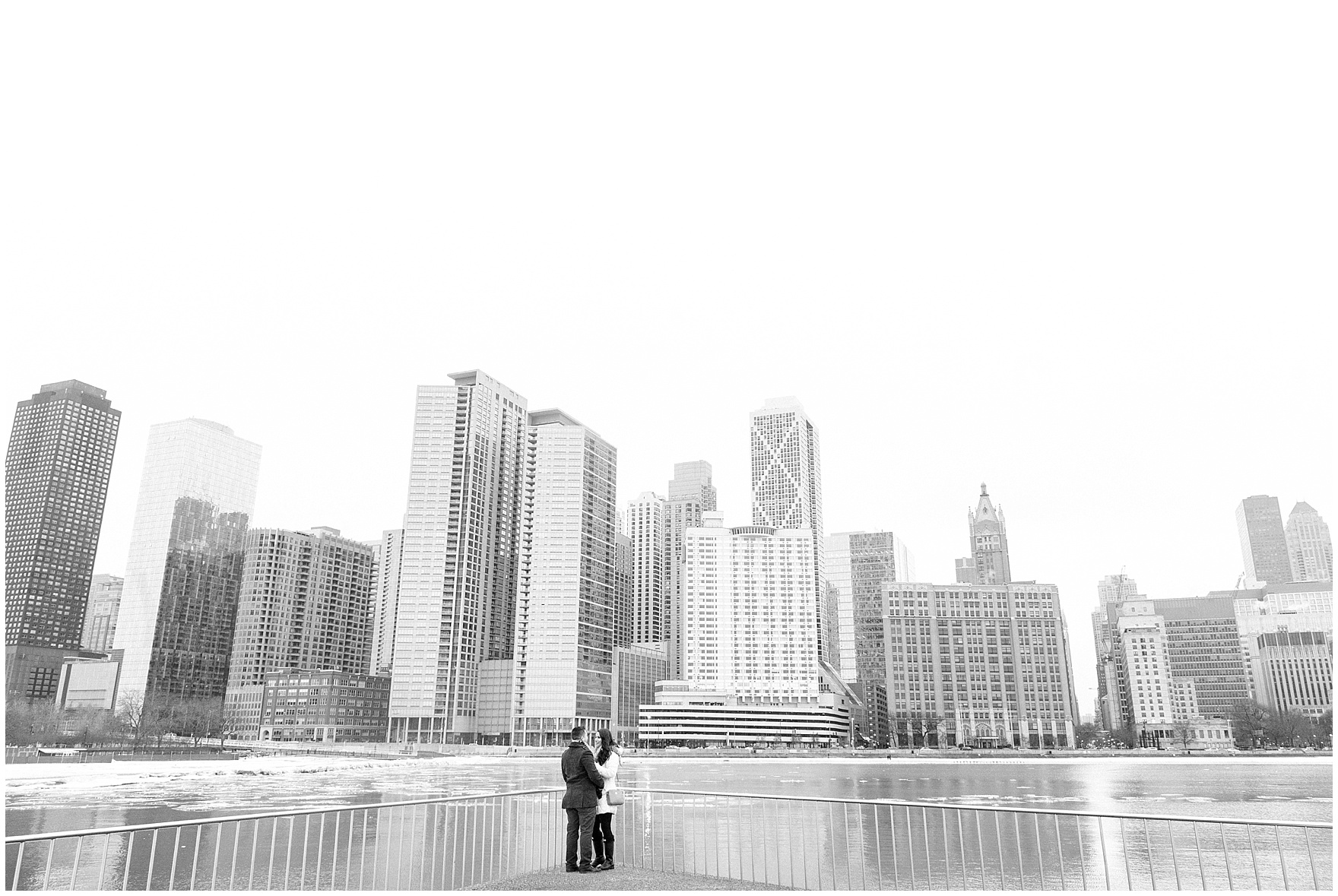 A couple stands on the promenade at MIlton Olive Park during a Chicago skyline proposal.