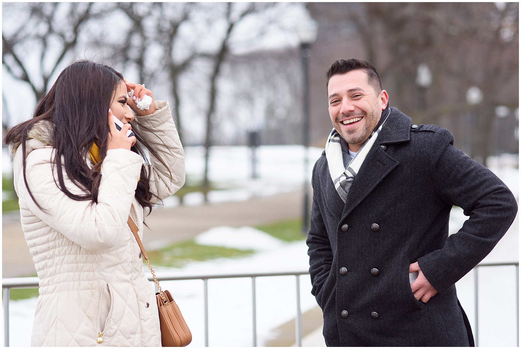 The bride and groom-to-be laugh and call family after a Chicago skyline proposal.