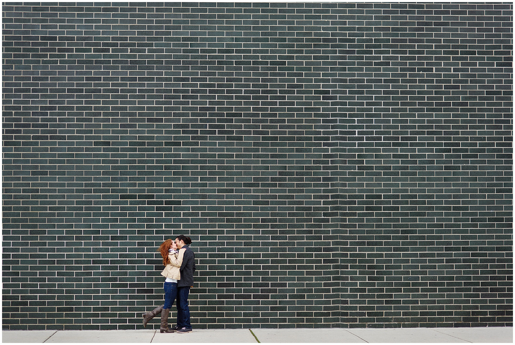 A couple kisses in the wind during their Chicago Windy City coffee shop engagement session.