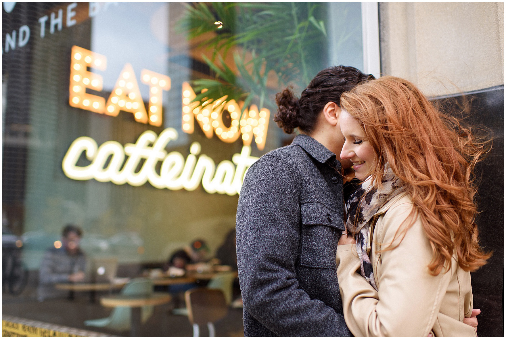 A couple embraces in front of a local coffee shop during their Chicago Windy City coffee shop engagement session.