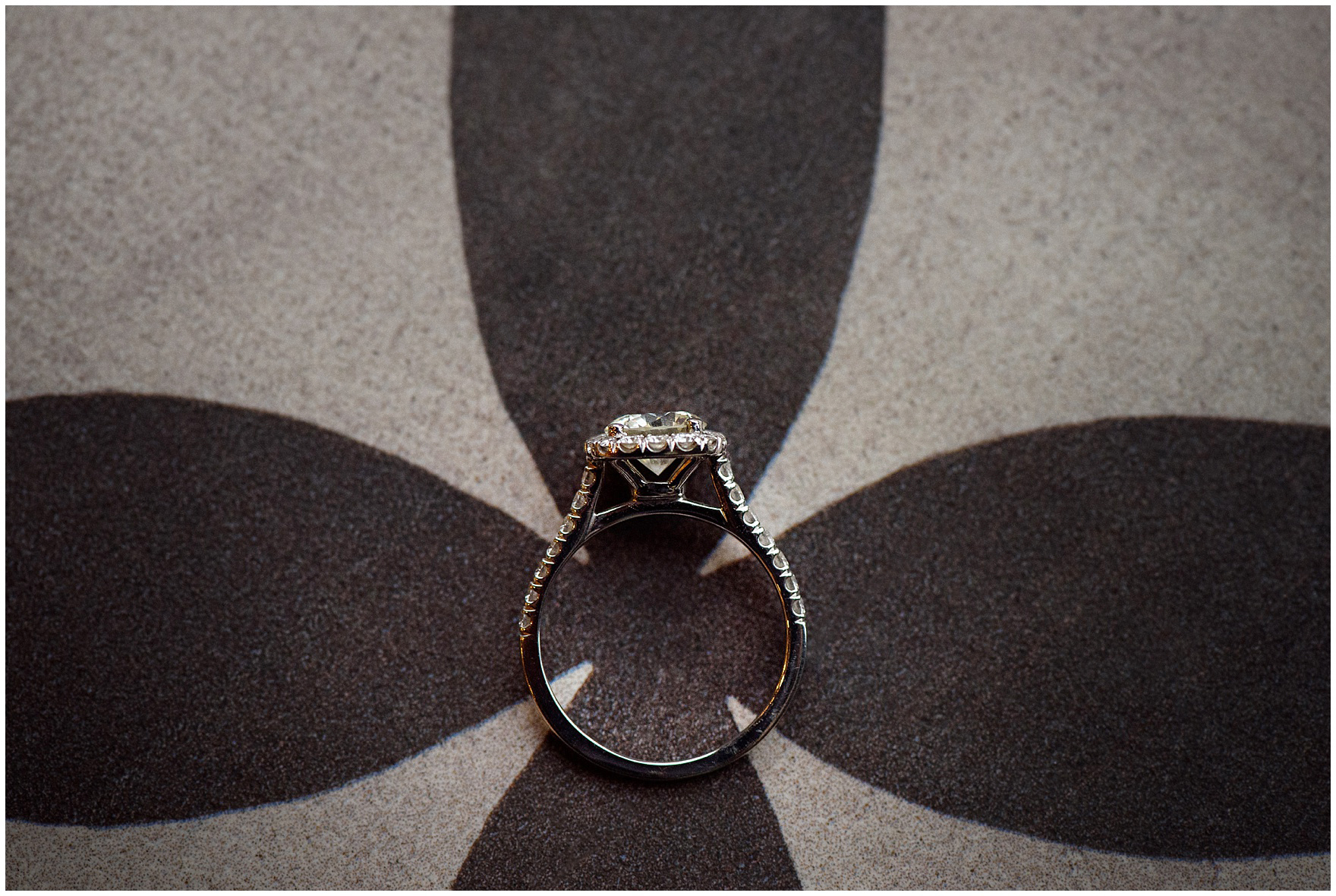 Close up photograph of an engagement ring on vintage tile during their Chicago Windy City coffee shop engagement session.