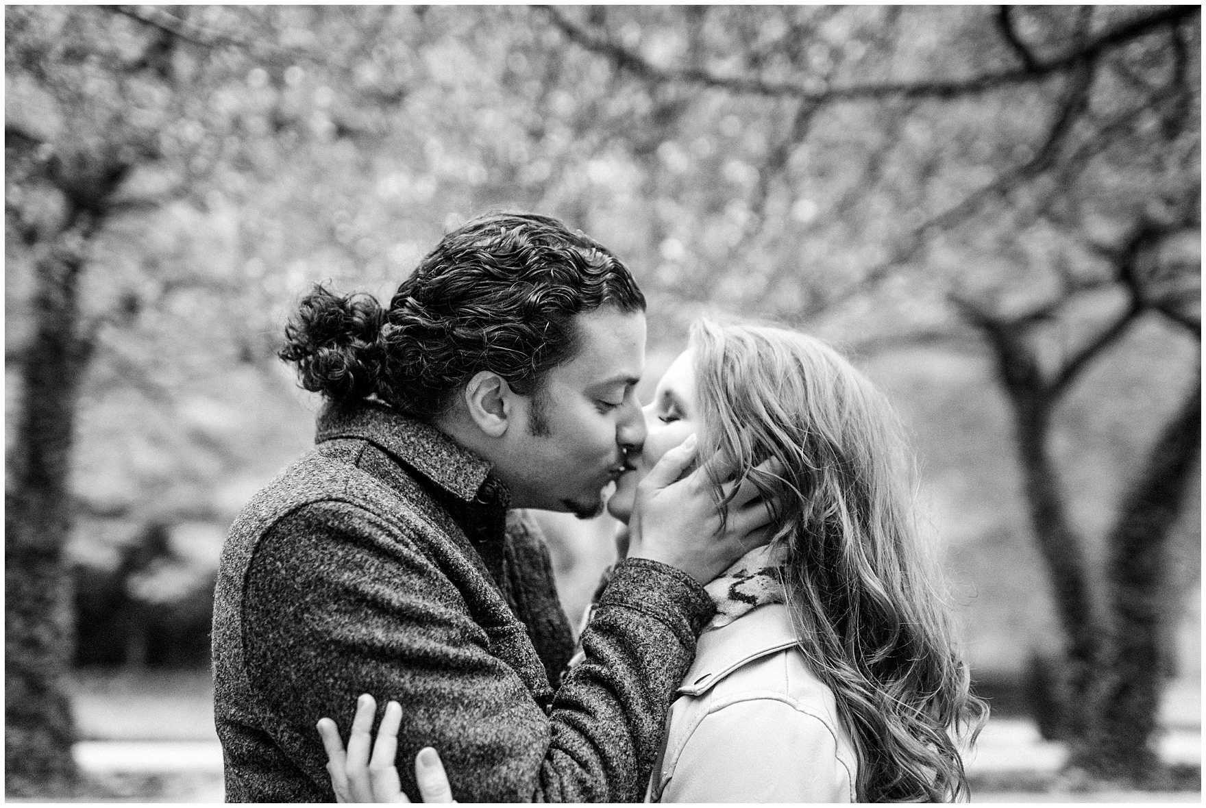 An engaged couple kisses in the Art Institute garden during their Chicago Windy City coffee shop engagement session.
