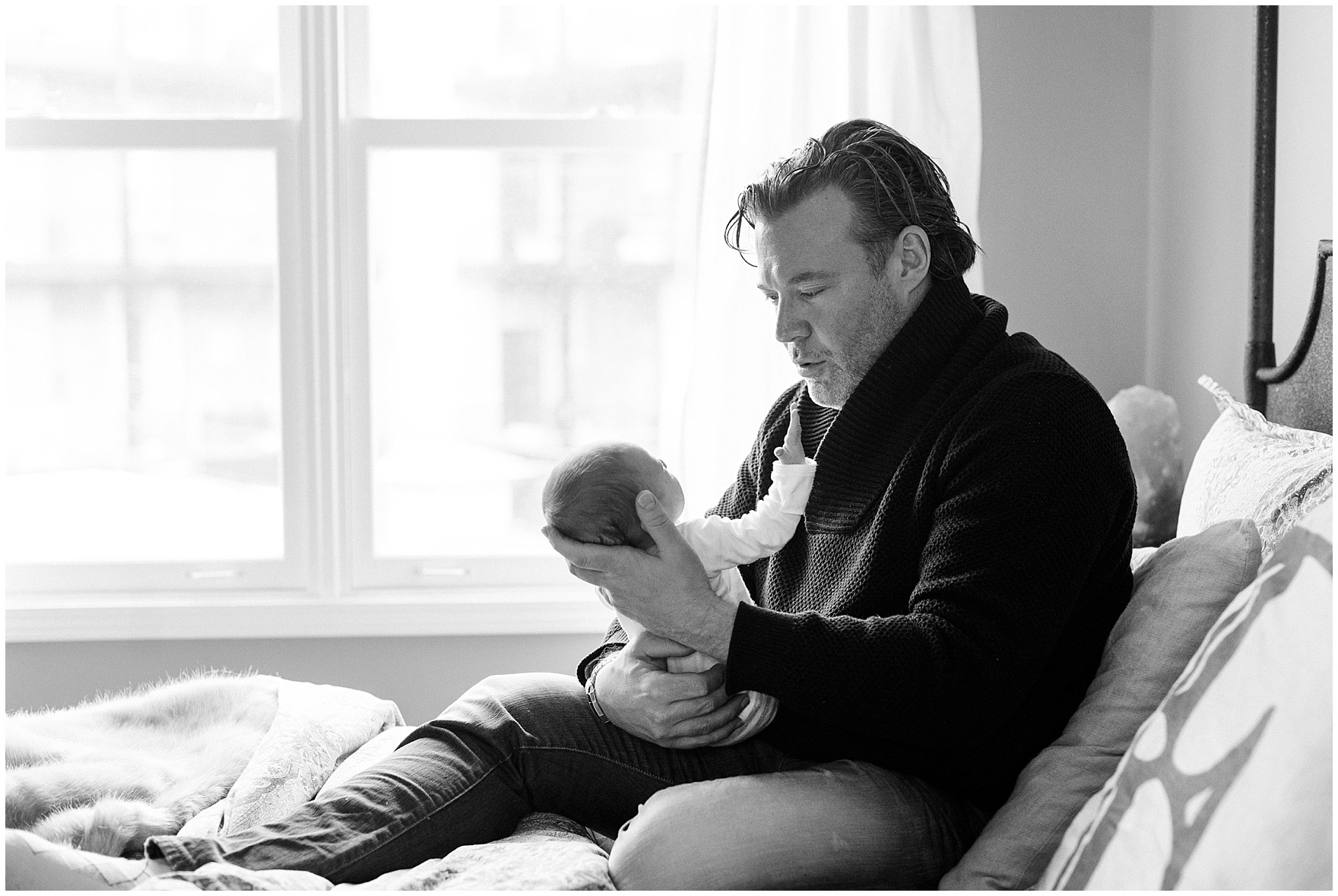Dad holds baby boy during a Lincoln Park lifestyle newborn session in Chicago.