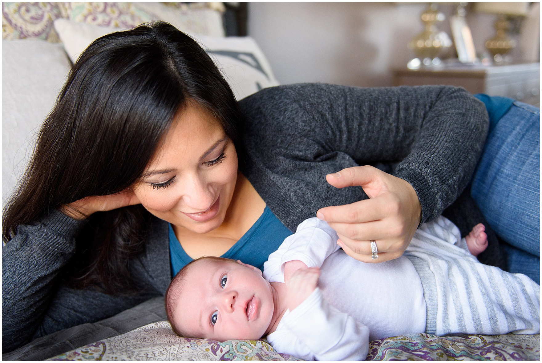 Mom cuddles baby boy during a Lincoln Park lifestyle newborn session in Chicago.