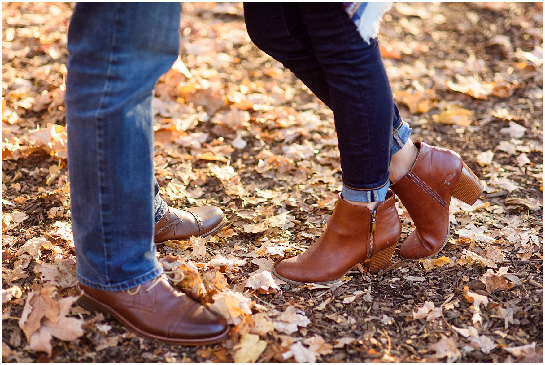 Detail of jeans and boots during a fall woods engagement session.
