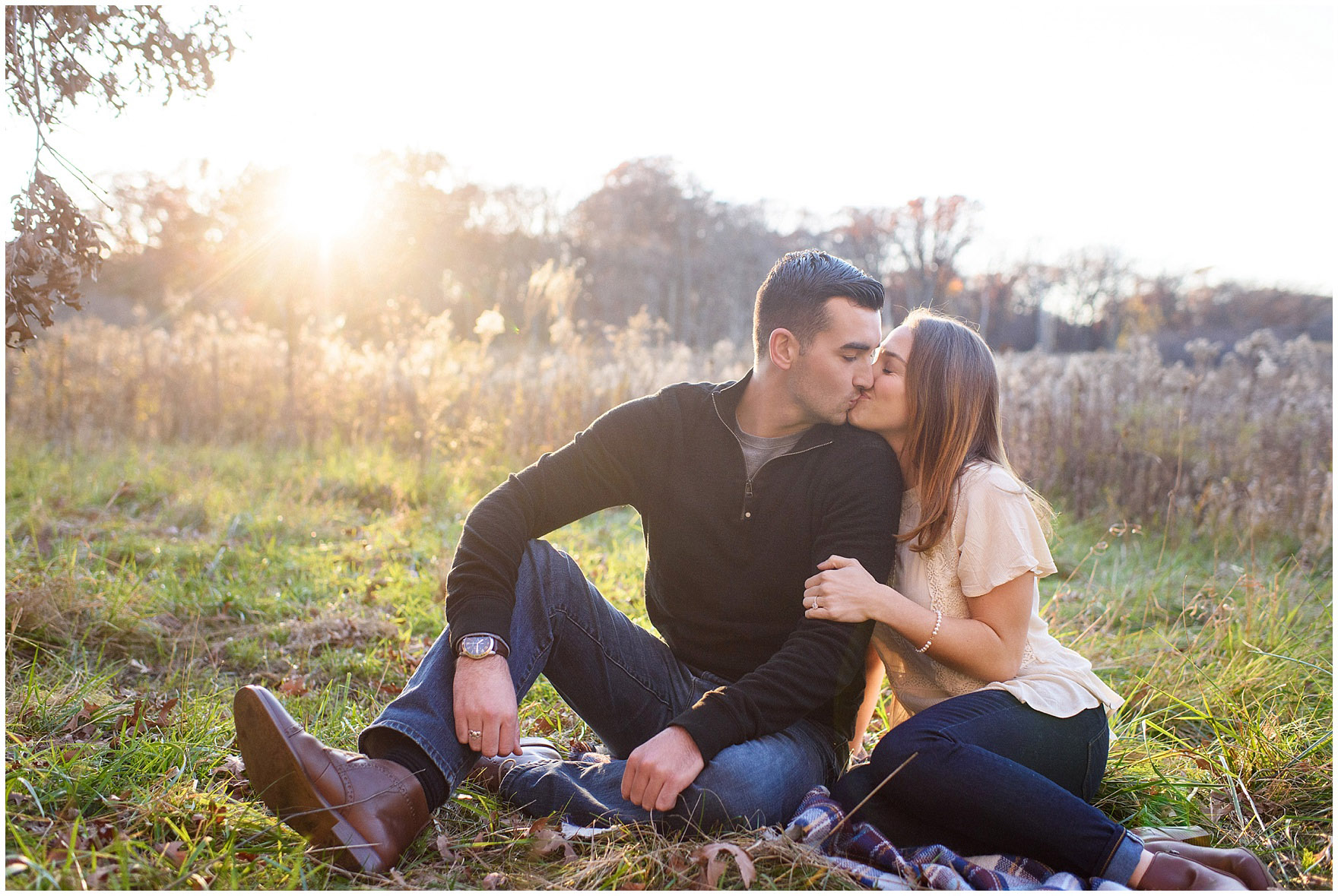 Kisses at sunset during a fall woods engagement session.