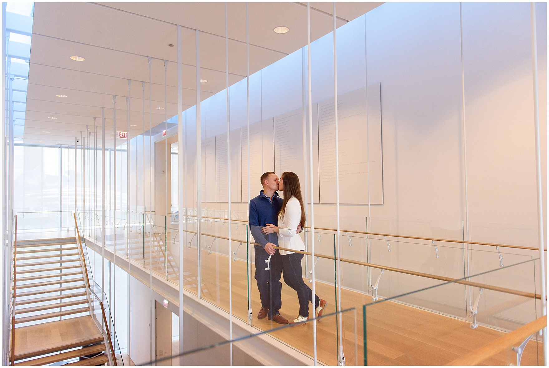 A couple walks through the museum during an Art Institute of Chicago engagement photography session.