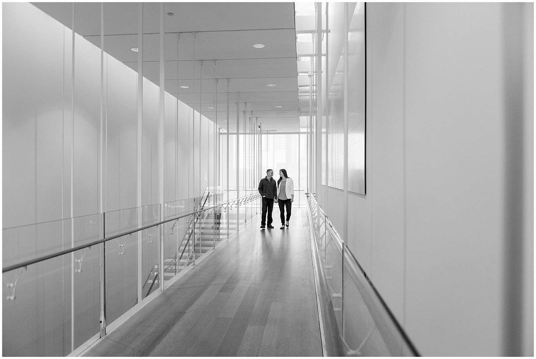 A couple walks in the Modern Wing during an Art Institute of Chicago engagement photography session.