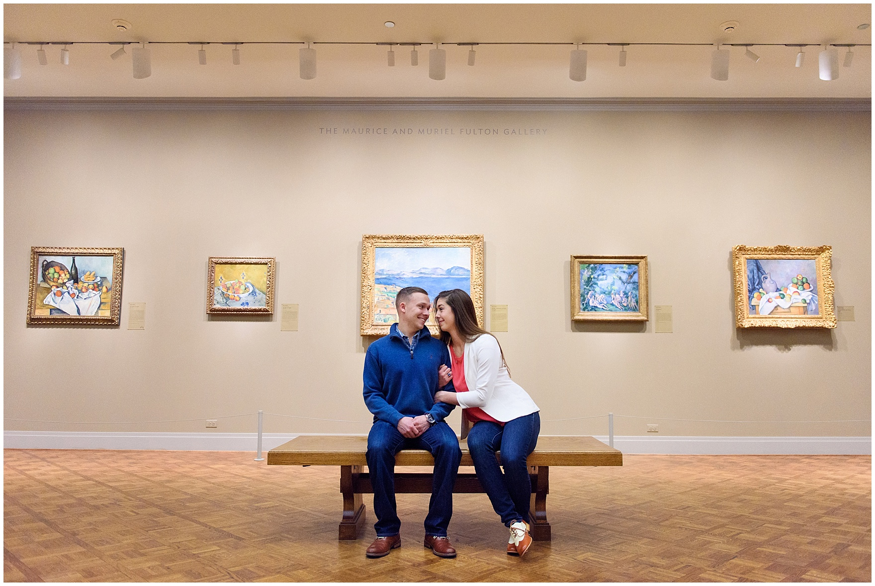 A bride and groom-to-be enjoy the Impressionist galleries during an Art Institute of Chicago engagement photography session.