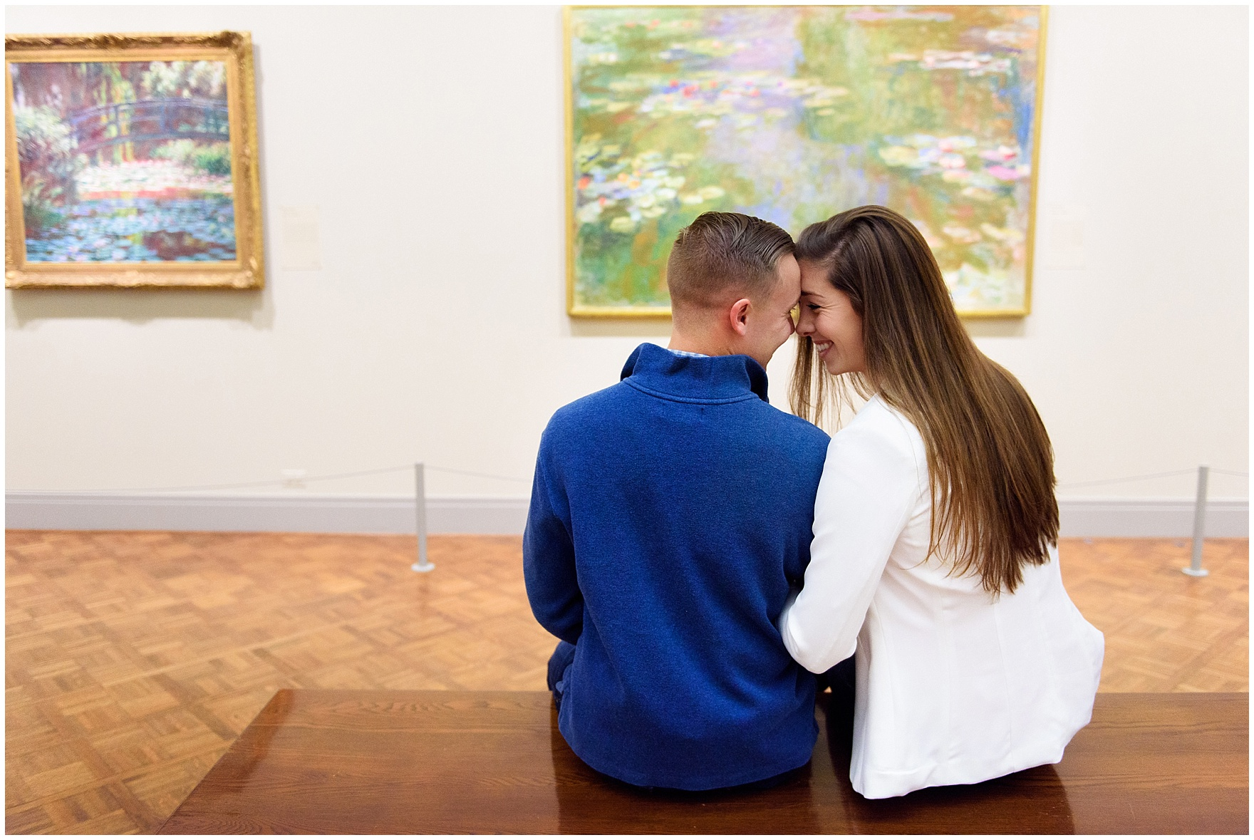 A couple sits in front of Monet's Water Lilies during an Art Institute of Chicago engagement photography session.