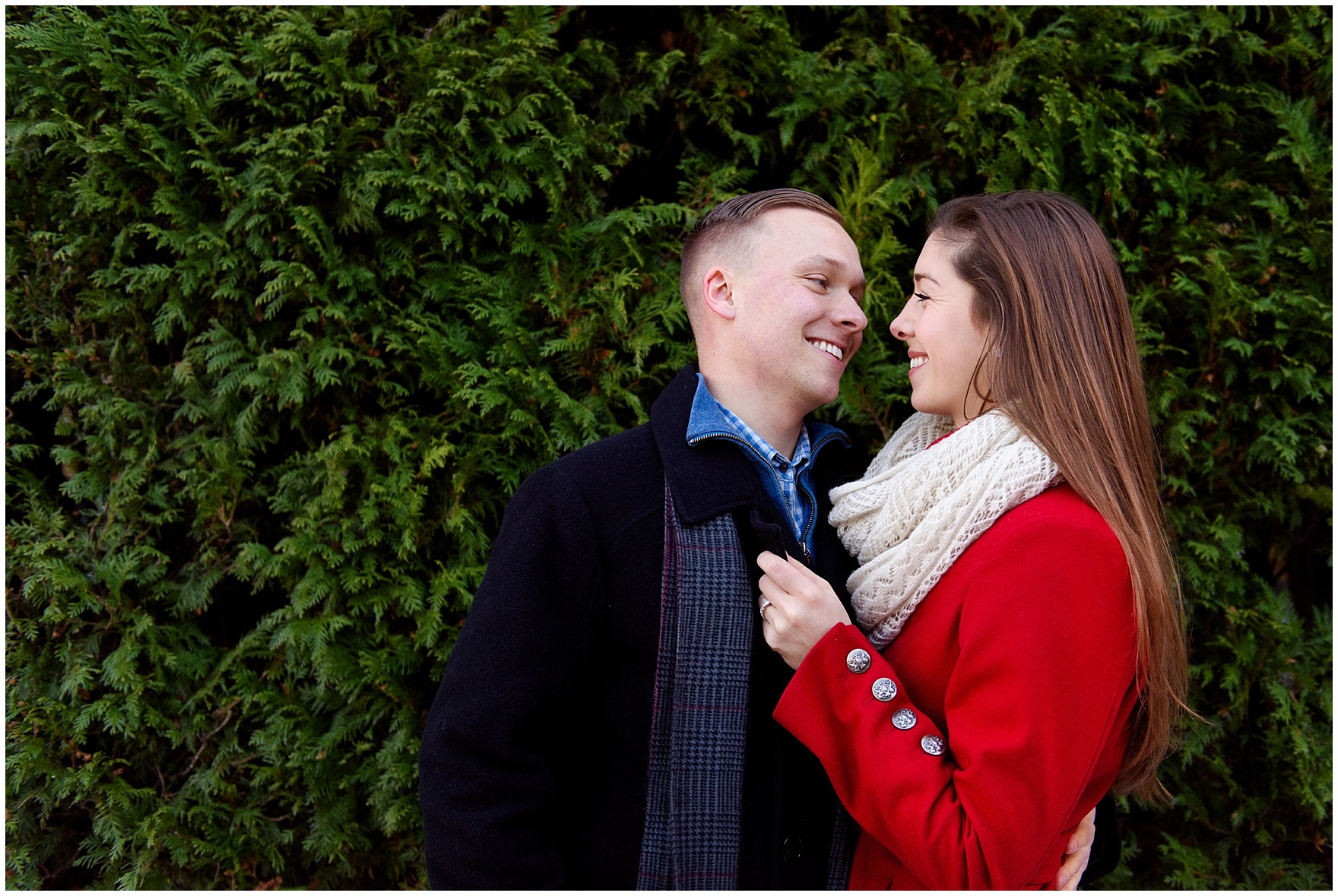 A couple embraces at the Lurie Gardens during an Art Institute of Chicago engagement photography session.