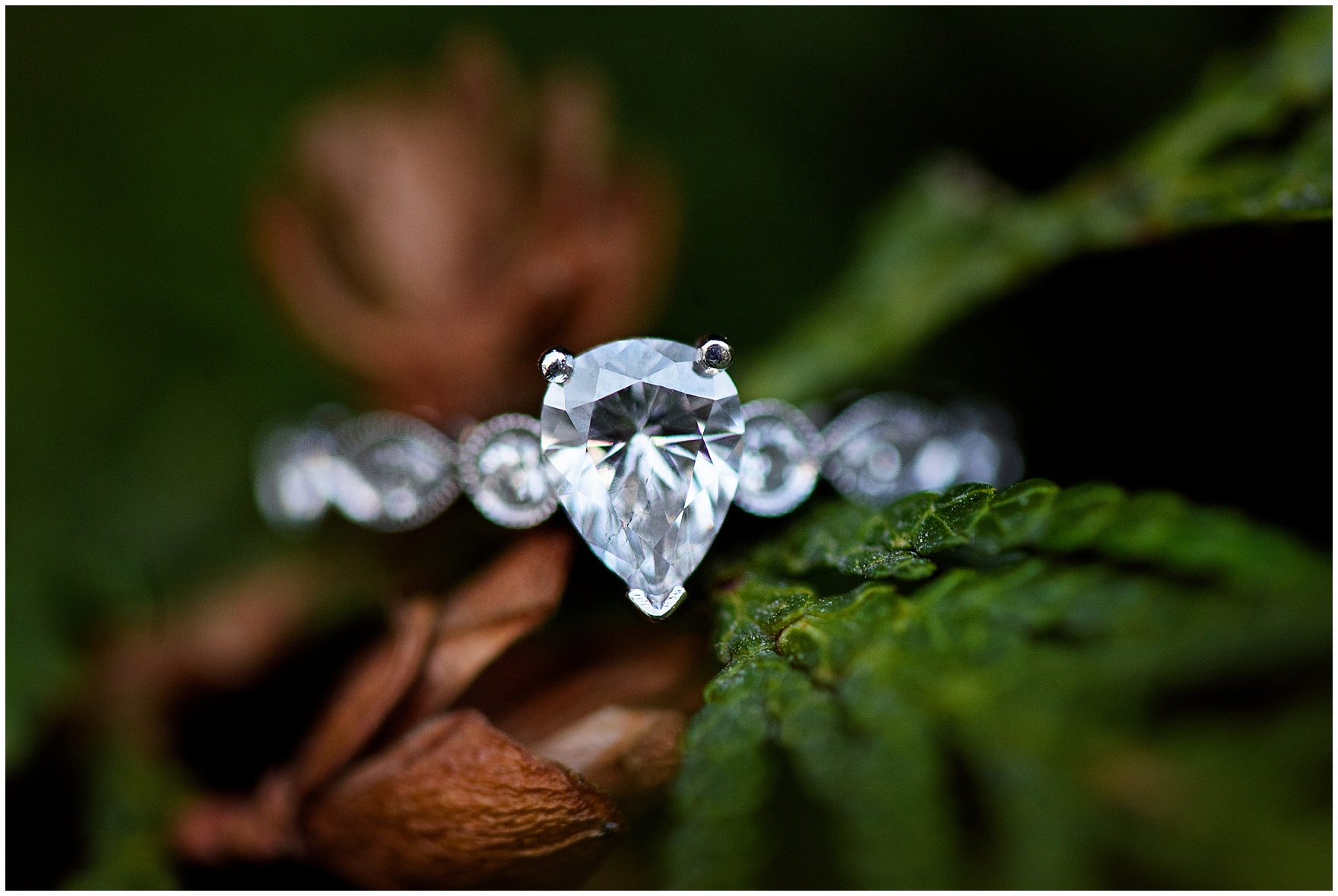 Close up photograph of a pear-shaped diamond engagement ring taken during an Art Institute of Chicago engagement photography session.
