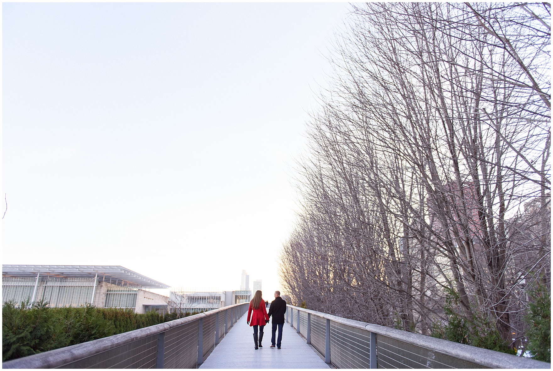 A couple walks up the bridge to the Modern Wing during an Art Institute of Chicago engagement photography session.