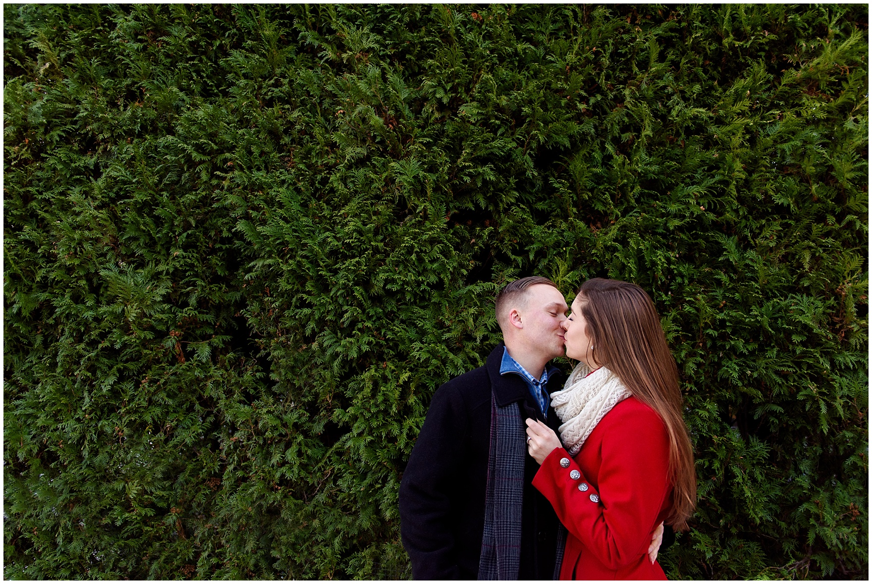 A couple embraces at Lurie Gardens during an Art Institute of Chicago engagement photography session.