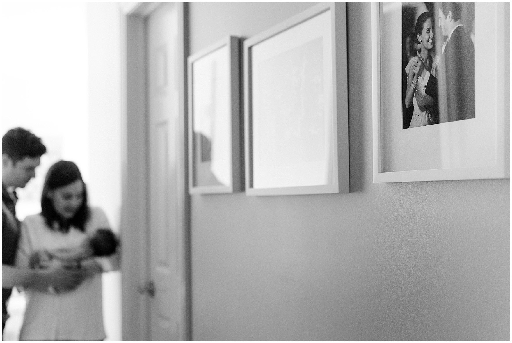 A couple's wedding portrait hangs on the wall during a Chicago newborn baby photography session.