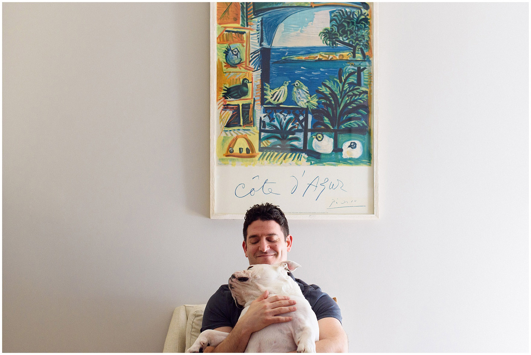 Dad plays with the dog during a Chicago newborn baby photography session.