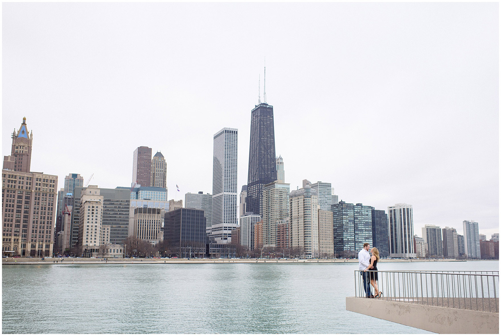 A bride and groom-to-be on the promenade at Milton Olive Park during a downtown Chicago city engagement photography session.