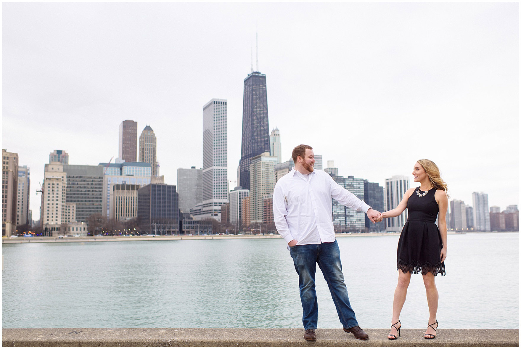 A couple poses in front of the skyline at Milton Olive Park during a downtown Chicago city engagement photography session.
