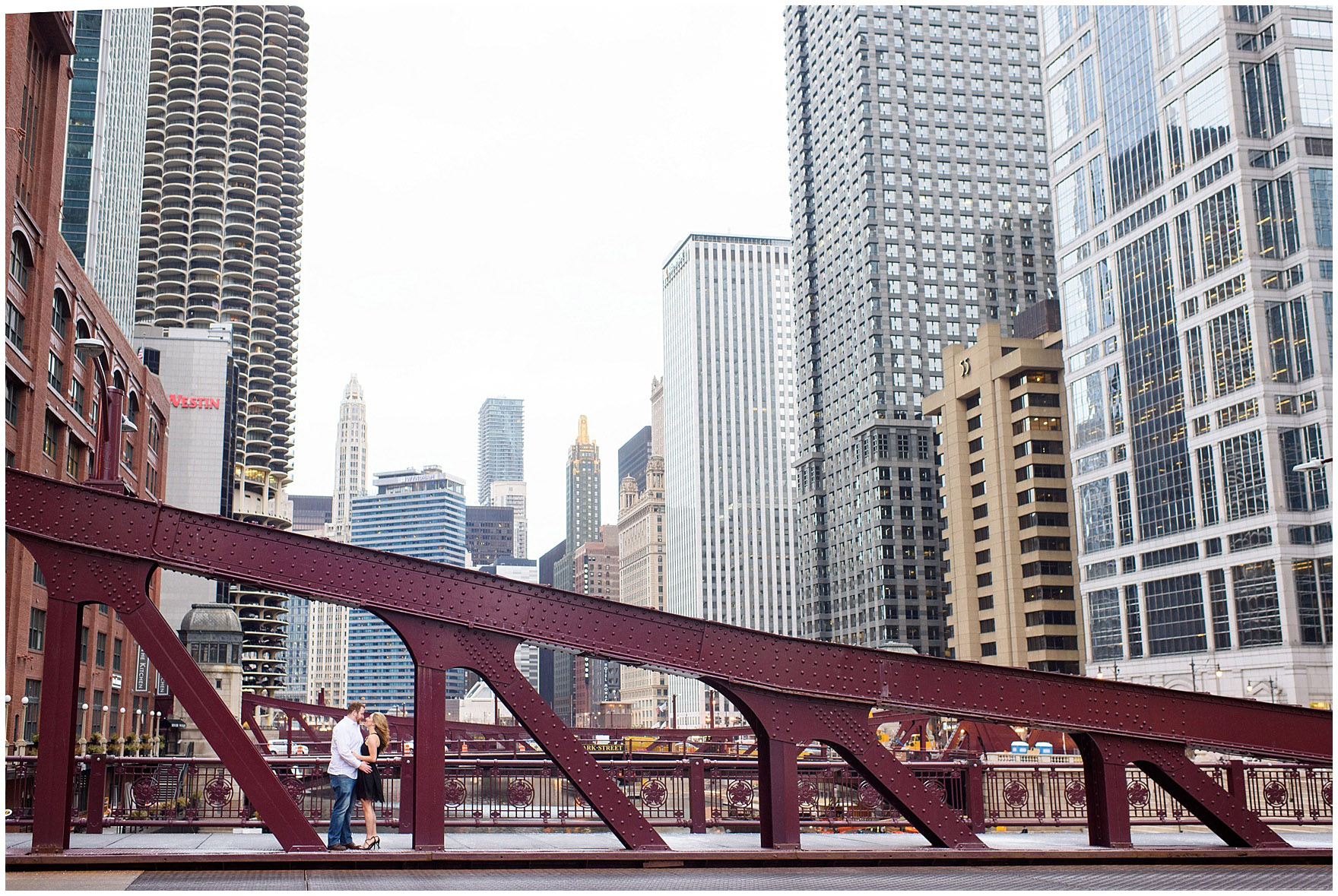 A couple walks on the LaSalle Street bridge during a downtown Chicago city engagement photography session.
