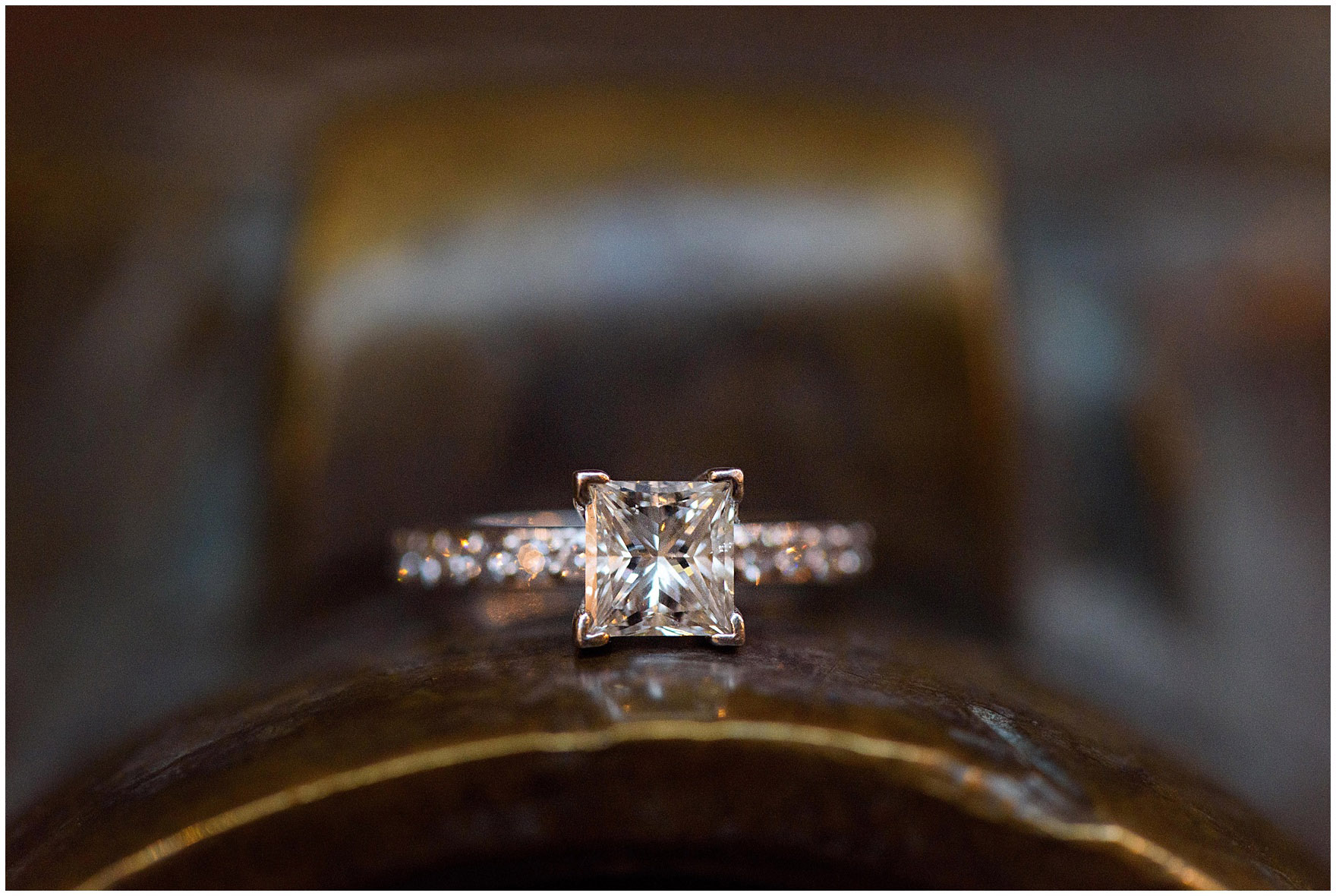 Close up photograph of a diamond engagement ring during a downtown Chicago city engagement photography session.