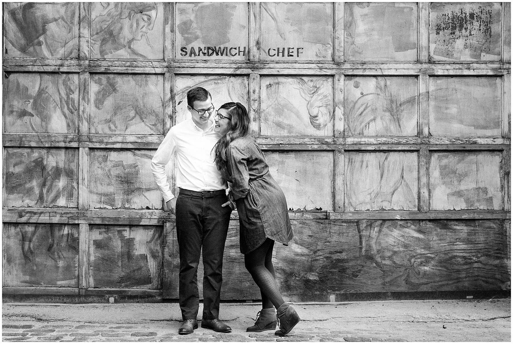A man and woman laugh during a West Loop Chicago photography session.