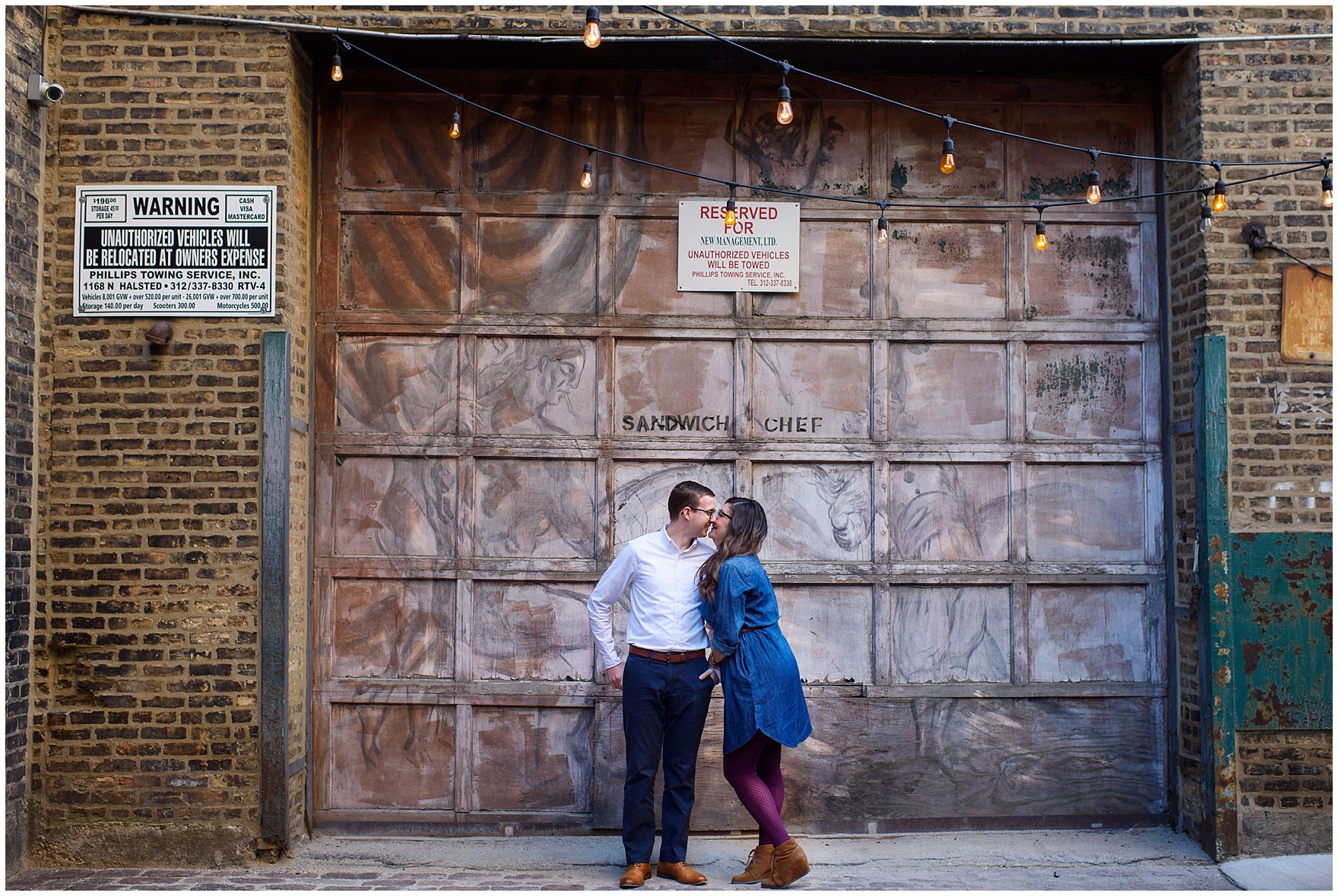 A couple grins and kisses in a fun urban alley during a West Loop Chicago photography session.