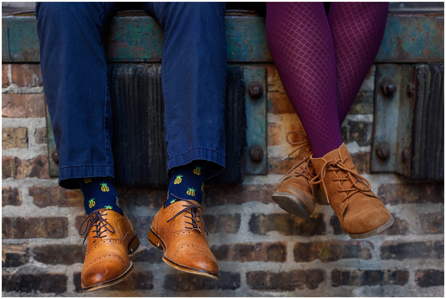 A couple sports brown shoes and fun socks and tights during a West Loop Chicago photography session.
