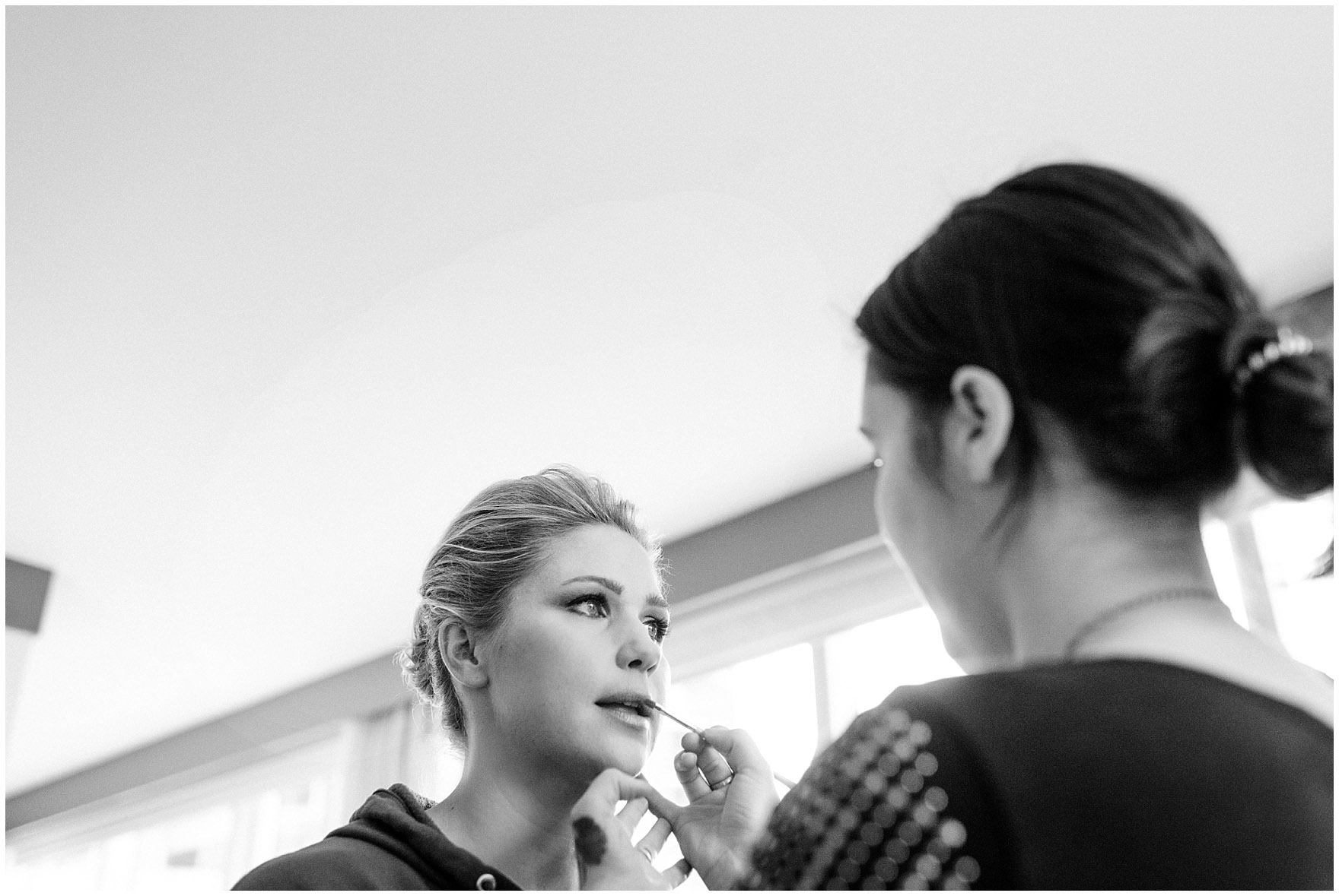 A bride gets her final makeup touches at the Loews Chicago Downtown hotel prior to her Ovation Chicago wedding.