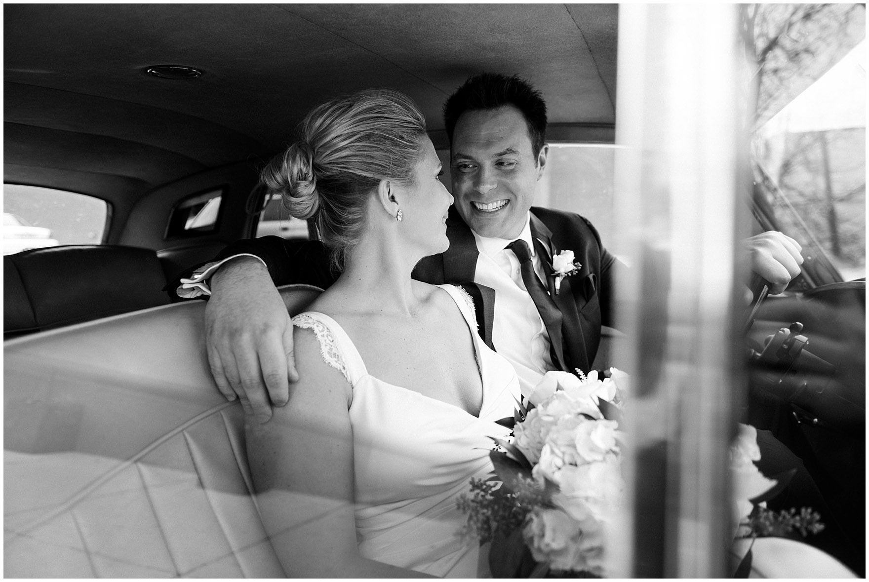 A bride and groom sit in a vintage Rolls Royce before an Ovation Chicago wedding.