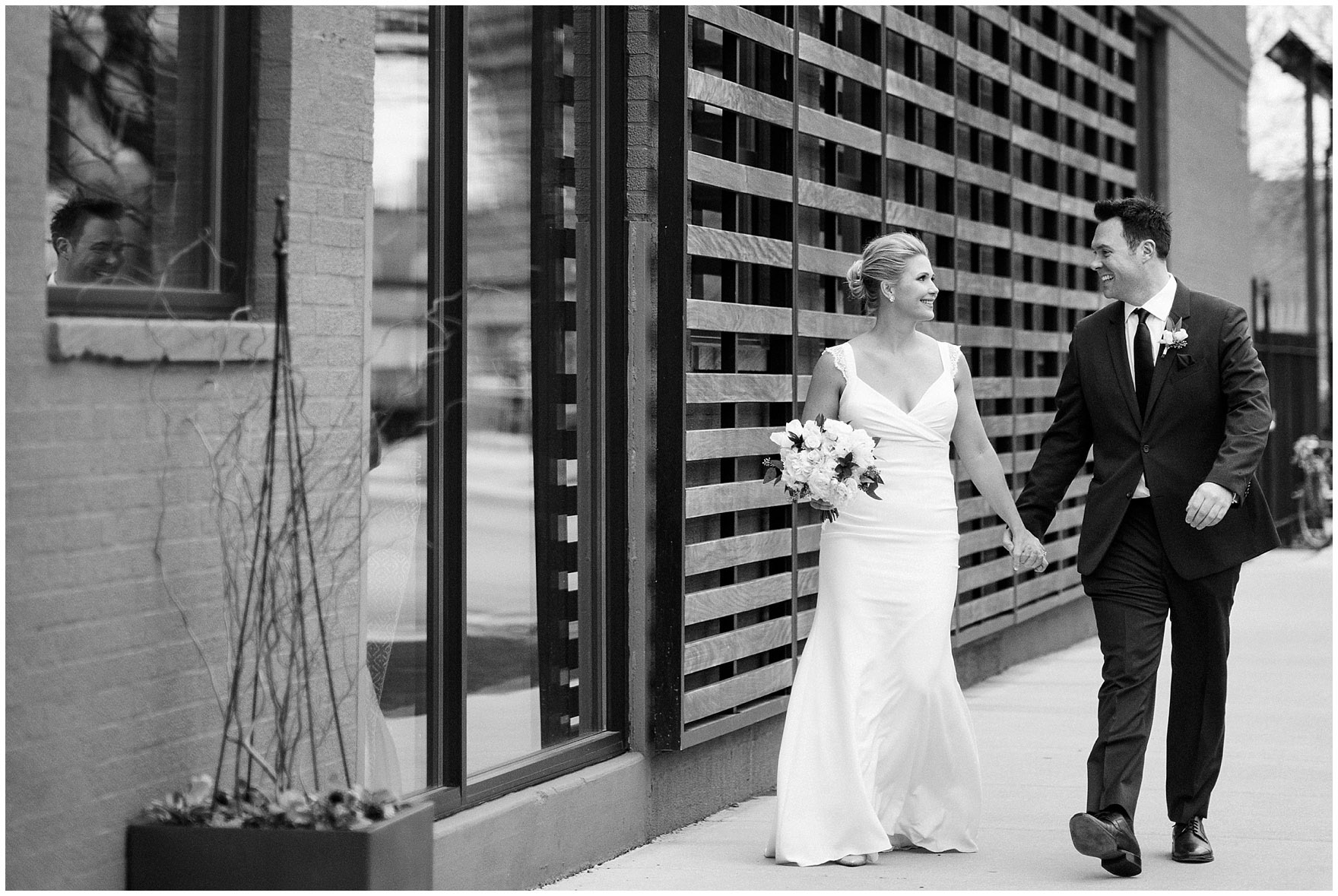 A bride and groom walk along Fulton Street before an Ovation Chicago wedding.