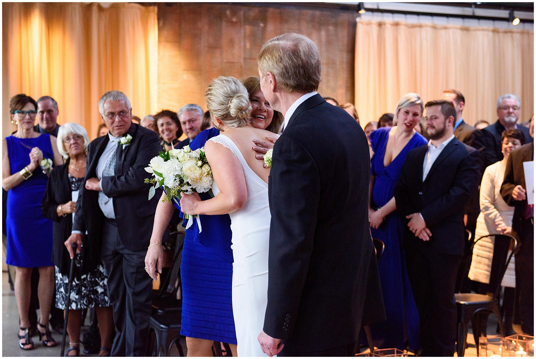 The bride hugs her parents at an Ovation Chicago wedding.