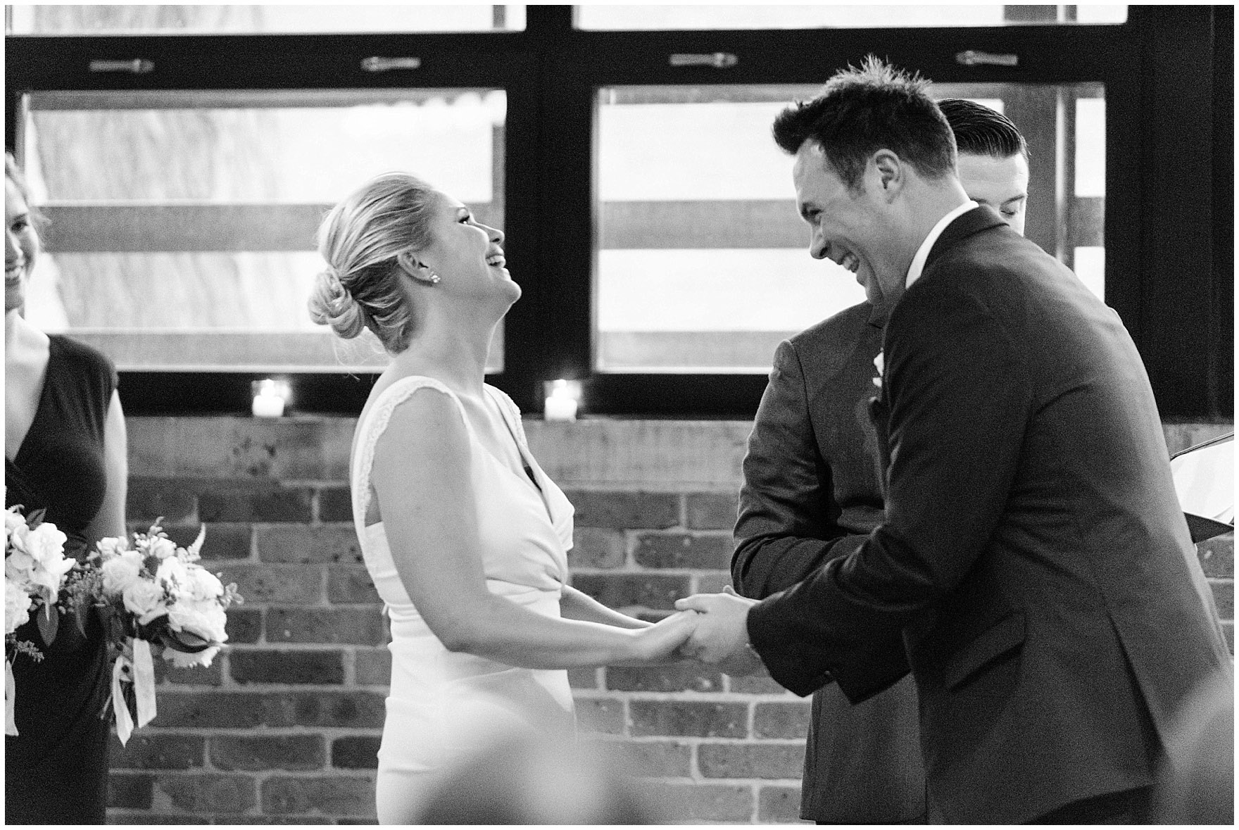 The bride and groom laugh during the ceremony for an Ovation Chicago wedding.