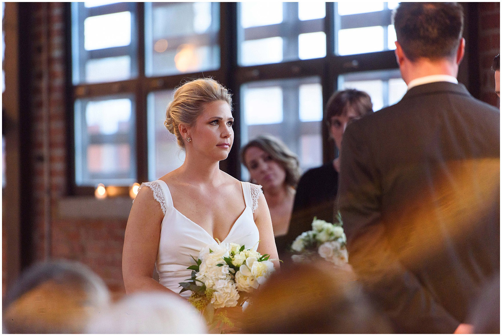 A bride tears up during the ceremony for an Ovation Chicago wedding.