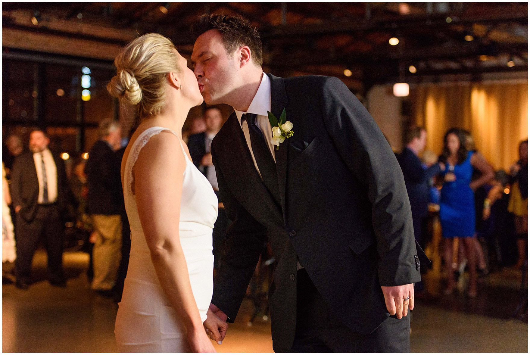 A bride and groom kiss on the dancefloor during an Ovation Chicago wedding.
