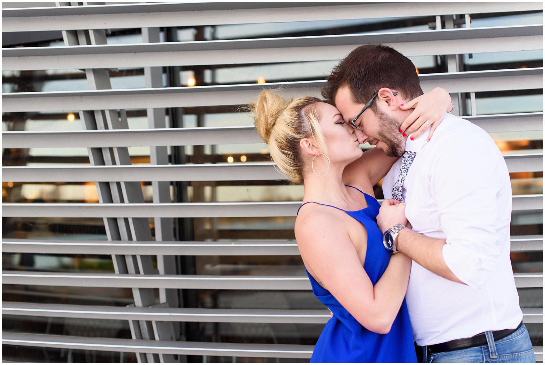 A couple kisses during a Chicago Navy Pier engagement photography session.