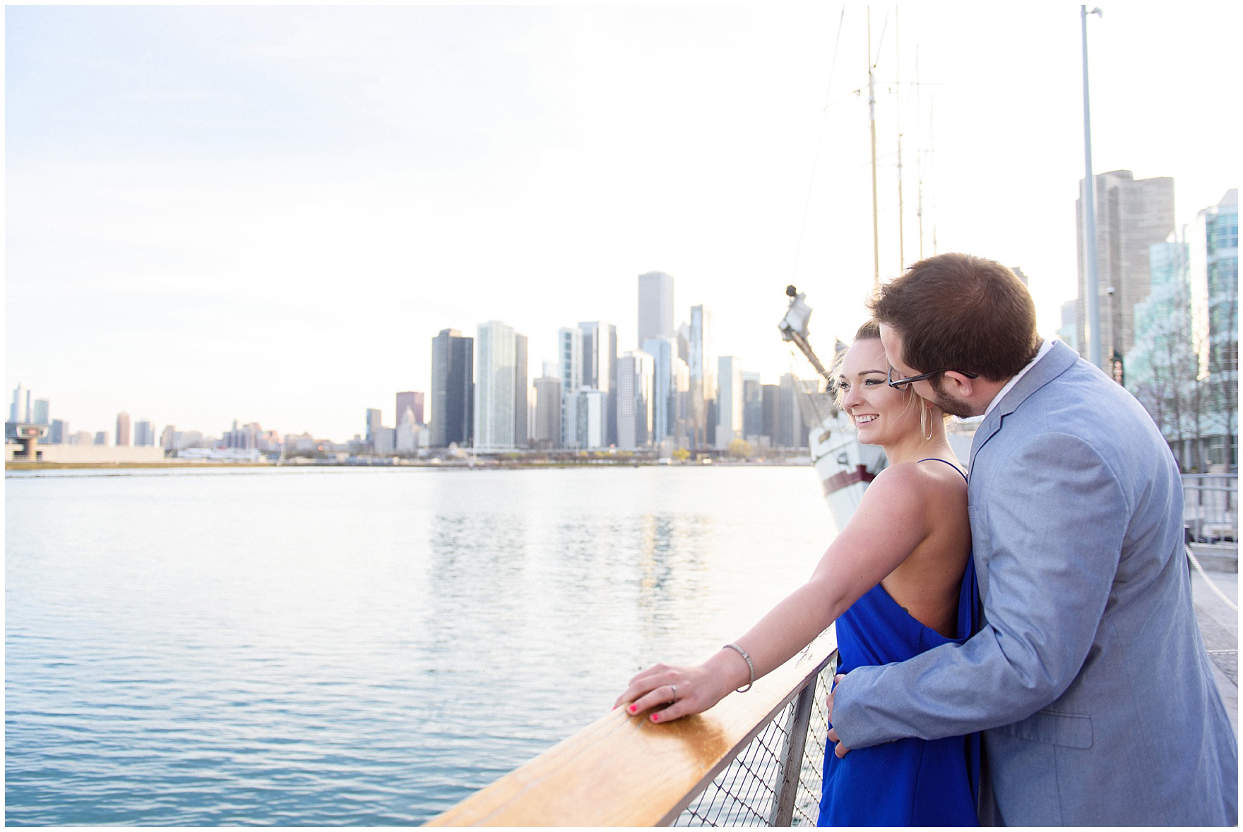 A couple takes in the Chicago skyline during a Chicago Navy Pier engagement photography session.
