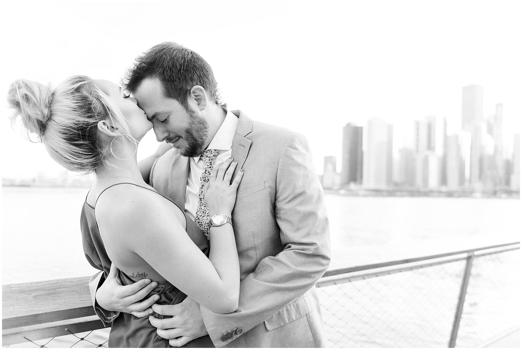 A black and white portrait of a bride and groom to be during a Chicago Navy Pier engagement photography session.