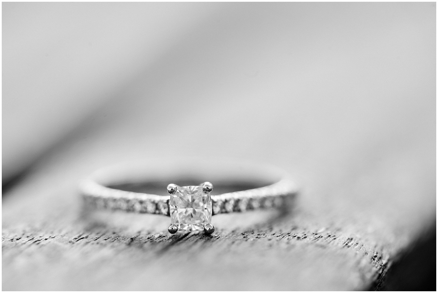 Close up of a diamond engagement ring during a Chicago Navy Pier engagement photography session.