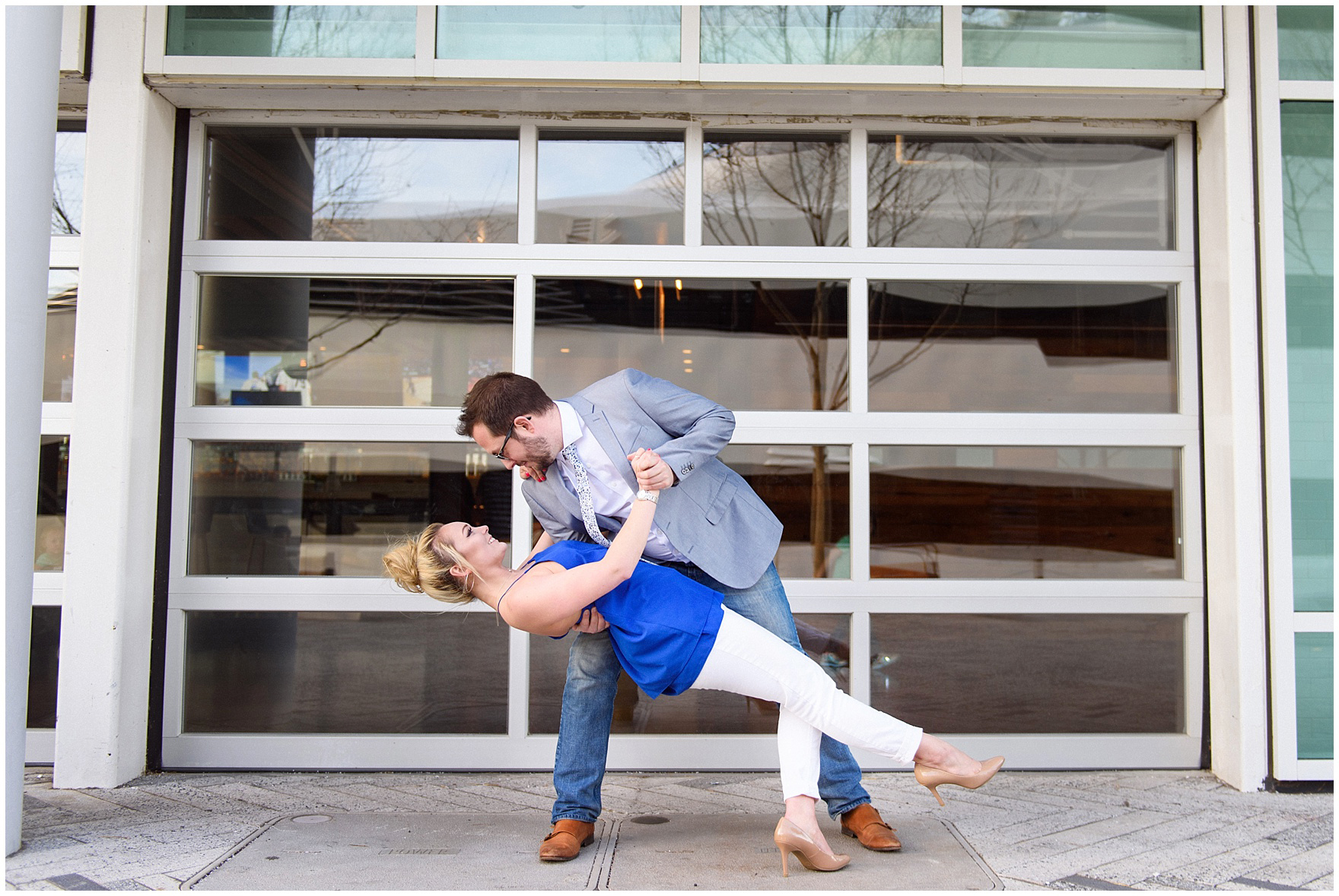 A man and woman dance during a Chicago Navy Pier engagement photography session.