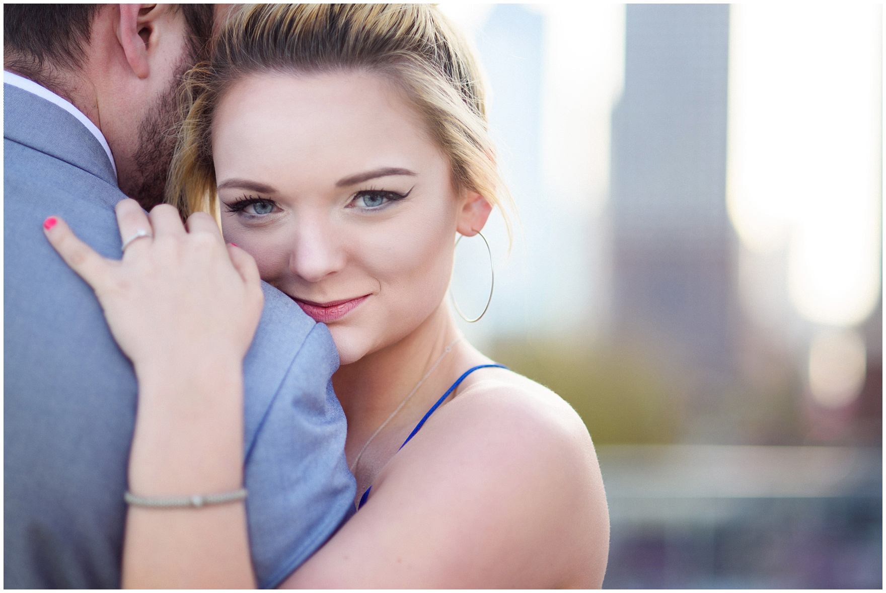 A newly-engaged woman hugs her fiance during a Chicago Navy Pier engagement photography session.