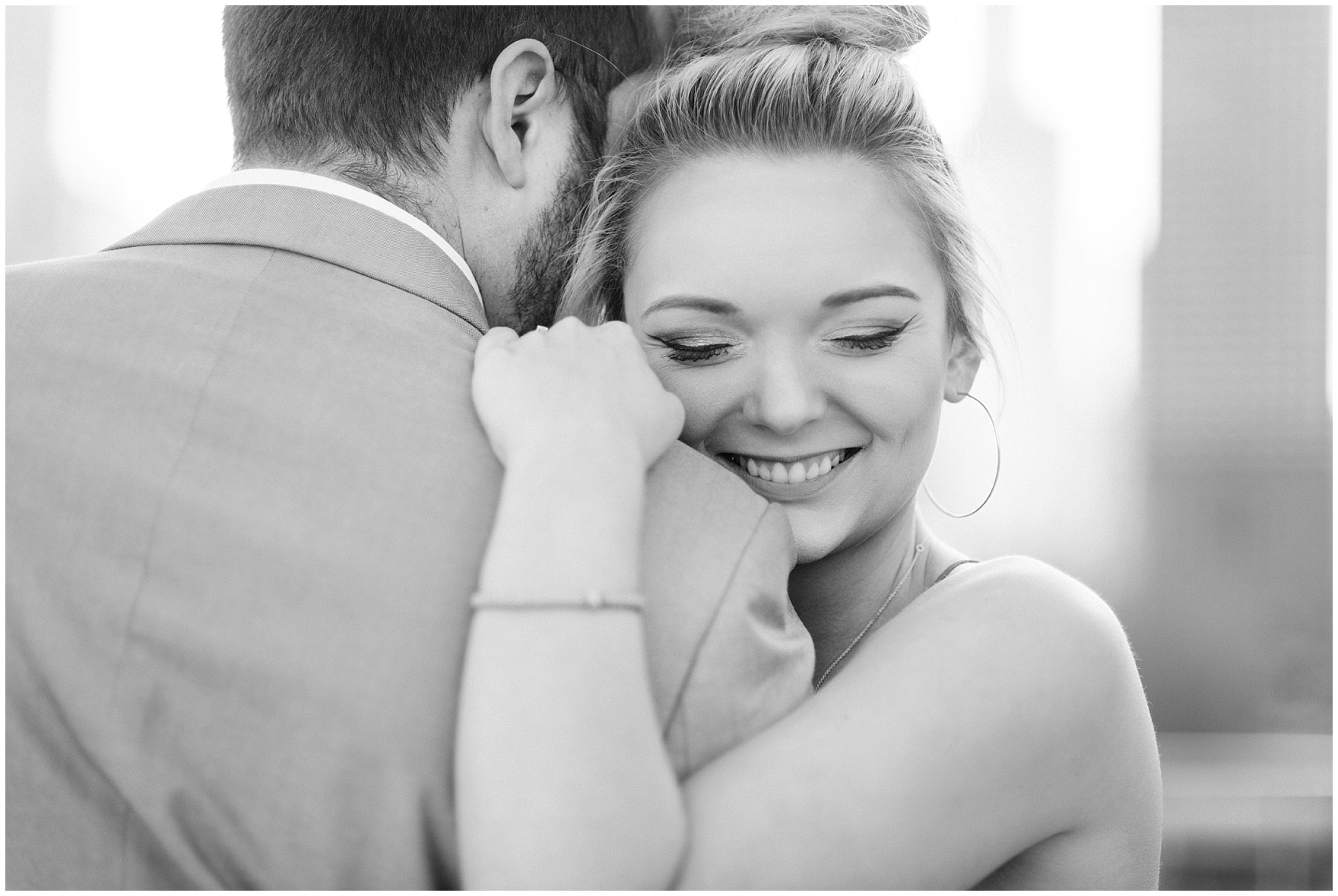 A bride to be smiles during a Chicago Navy Pier engagement photography session.