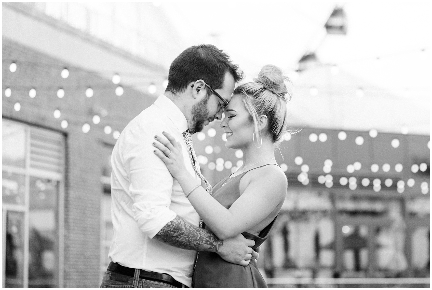 A couple embraces during a Chicago Navy Pier engagement photography session.