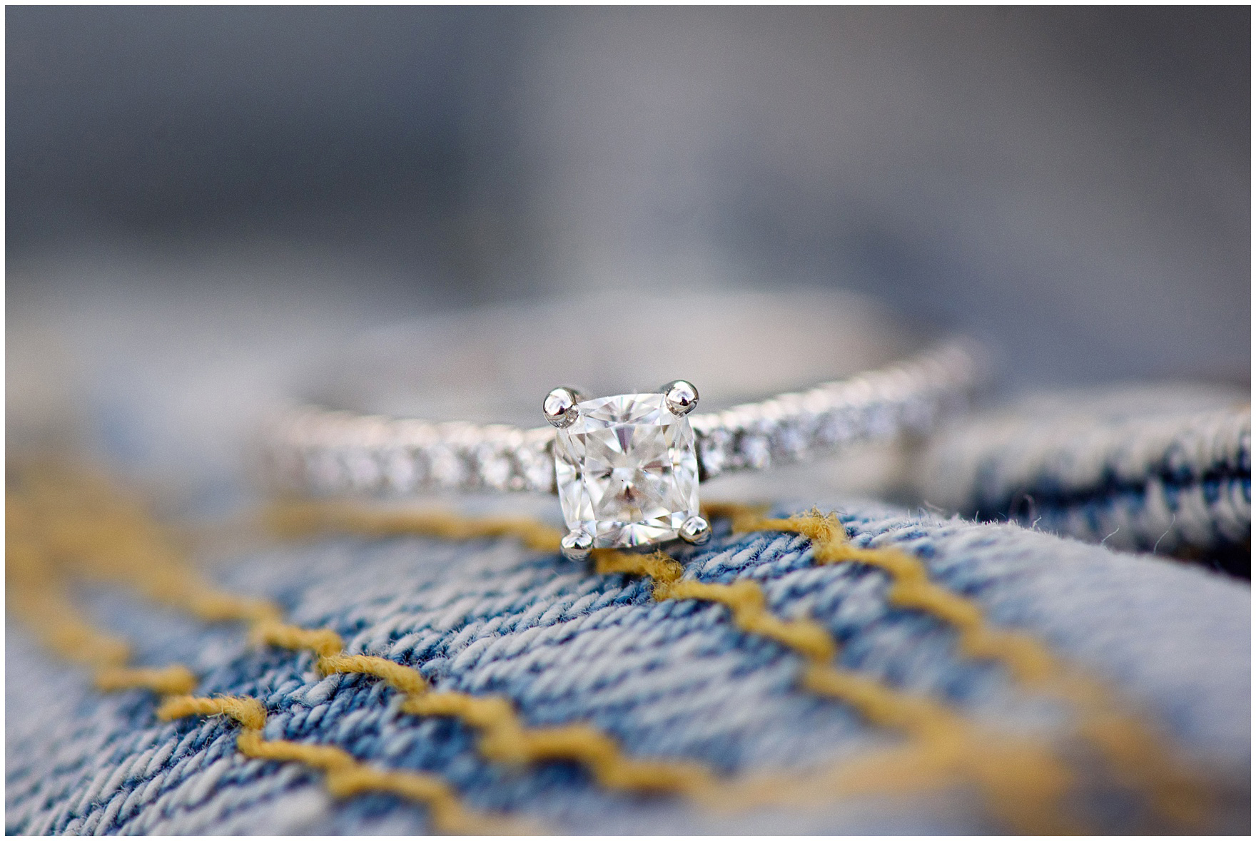 Close up of a square-cut diamond engagement ring during a Chicago Navy Pier engagement photography session.