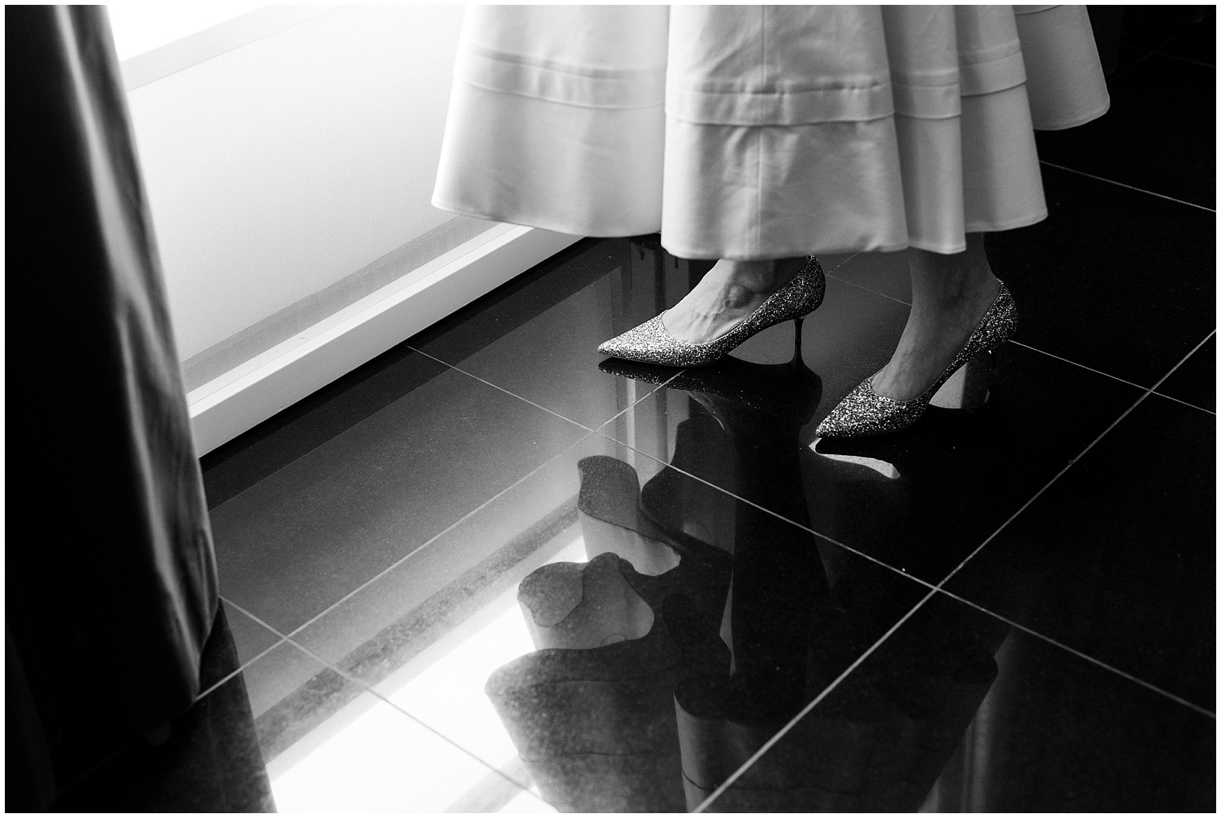 The bride wears Jimmy Choo kitten heels with a cocktail length dress, for her St. Nicholas Ukrainian Church and downtown Chicago East Bank Club wedding.