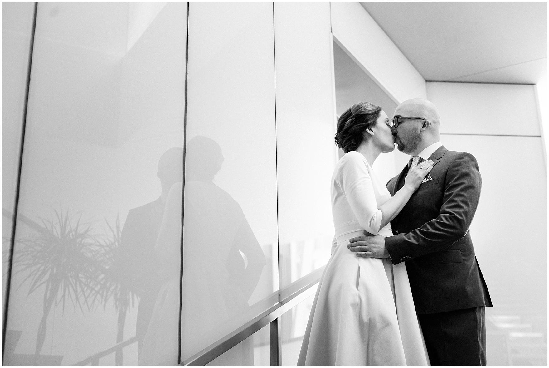 A bride and groom kiss at the Sofitel Chicago, before their St. Nicholas Ukrainian Church and downtown Chicago East Bank Club wedding.