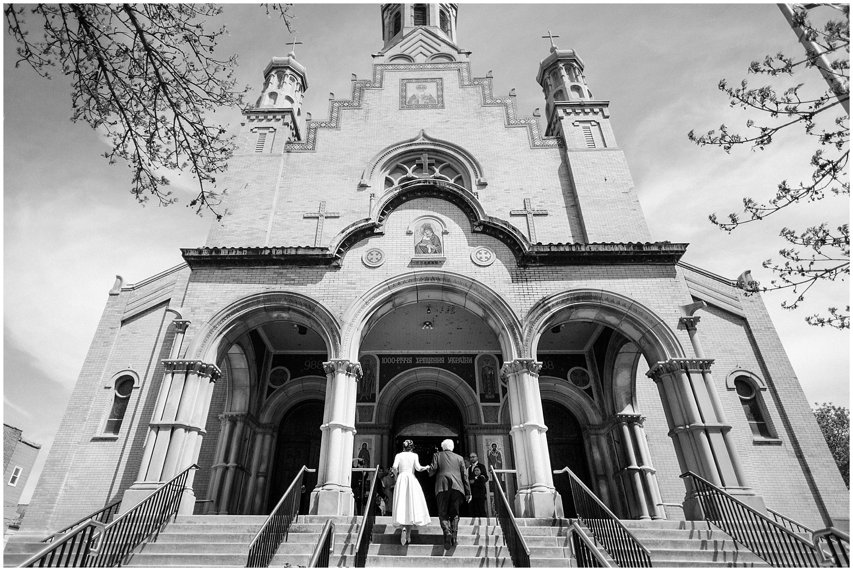 The bride and her father walk up the steps of the church, for a St. Nicholas Ukrainian Church and downtown Chicago East Bank Club wedding.
