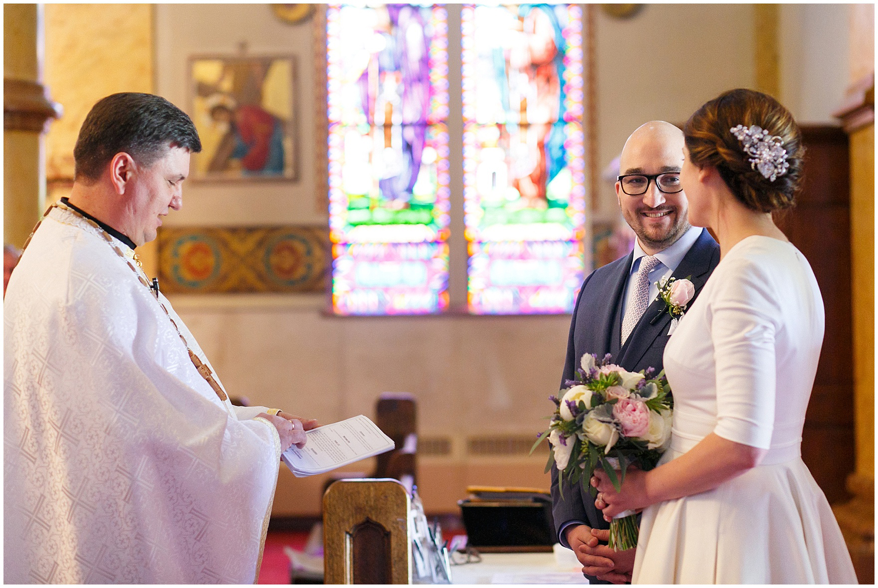 The priest greets the bride and groom during a St. Nicholas Ukrainian Church and downtown Chicago East Bank Club wedding.