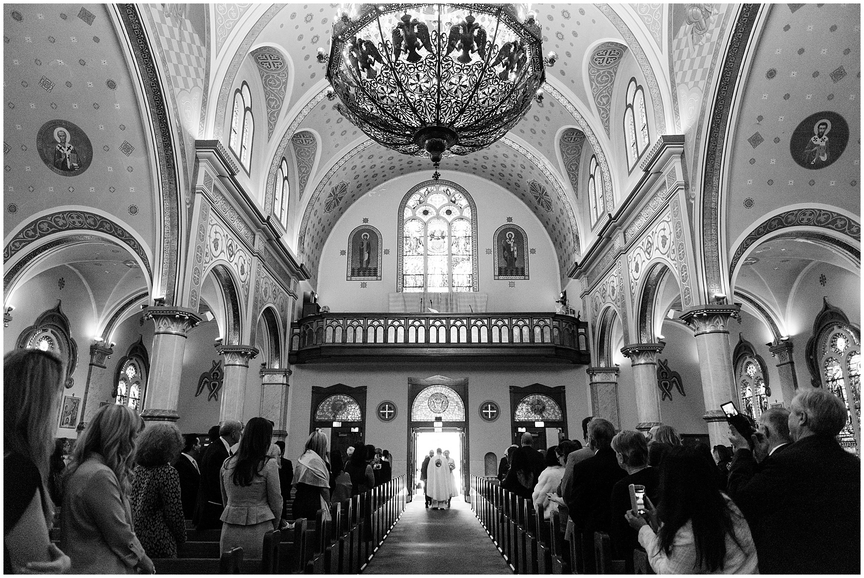 The bride and groom enter the church for a St. Nicholas Ukrainian Church and downtown Chicago East Bank Club wedding.