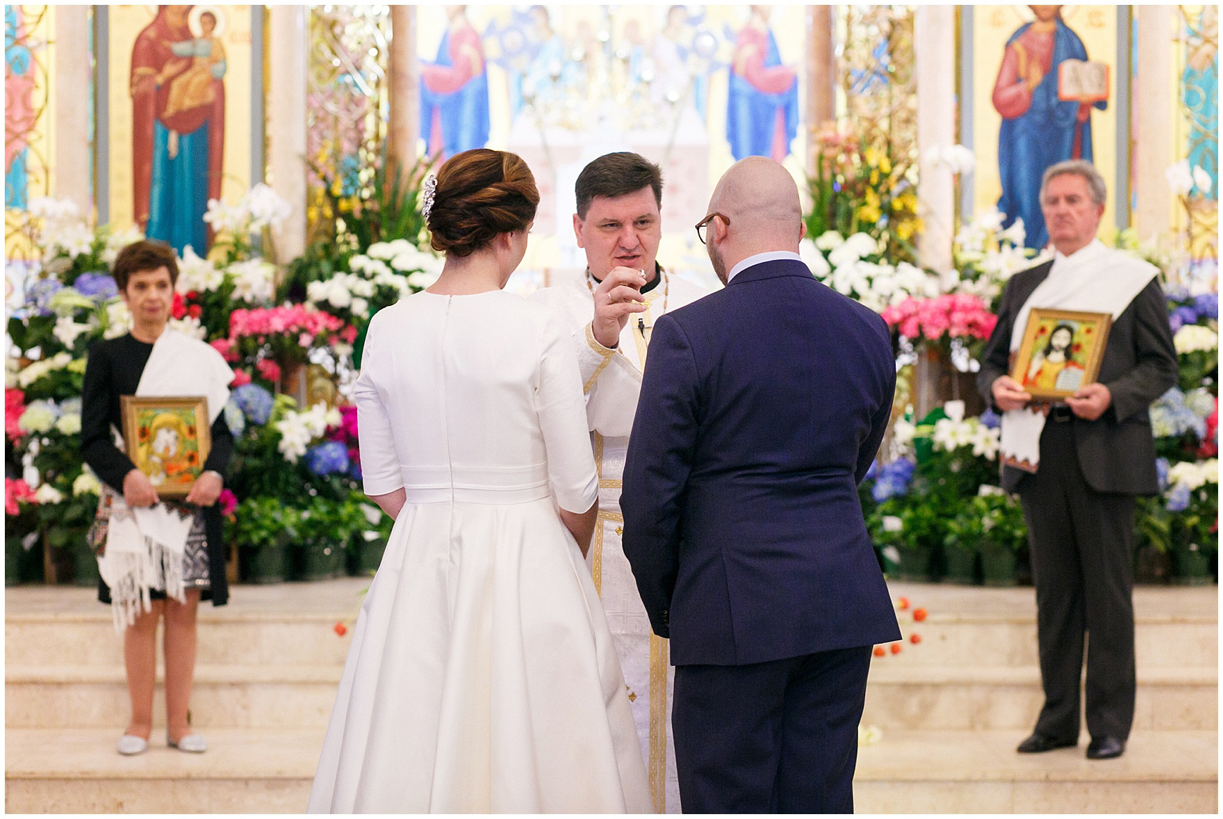 The bride and groom exchange rings during a St. Nicholas Ukrainian Church and downtown Chicago East Bank Club wedding.